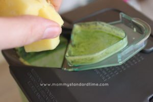 adding frozen pineapple to smoothie