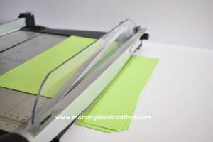 cutting paper strips for shamrocks