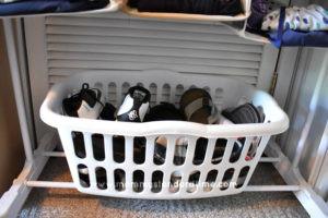 basket of shoes on child clothing organizer