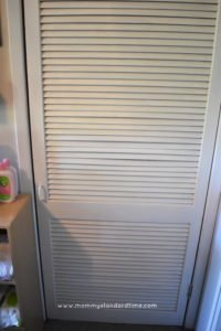 door to furnace closet - child clothing organization