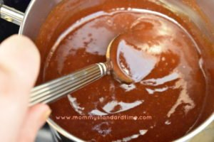 stirring barbecue sauce