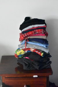 Nightstand with Pile of Clothes Before KonMari Method - Mommy Standard Time Blog