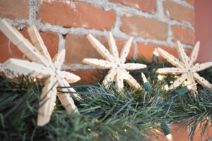 three wooden snowflake ornaments