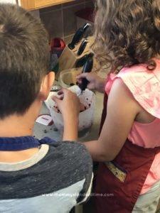 kids preparing berries for jam